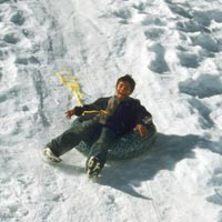 A young sledder enjoys the ride